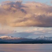 Three weeks aboard the Kong Harald. Hurtigruten, the Coastal Express. The landscape of a midnight sun near Molde.