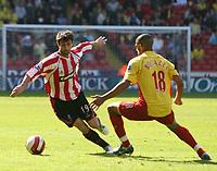 Photo: Mark Stephenson.<br /> Sheffield United v Watford. The Barclays Premiership. 28/04/2007.Sheffield's Keith Gillespie skips around Watford' Hameur Bouazza