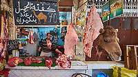 Camel Butcher Shop in the Medina of Fes. Image taken with a Fuji X-T1 camera and Zeiss 12 mm f/2.8 lens (ISO 200, 12 mm, f/2.8, 1/70 sec).