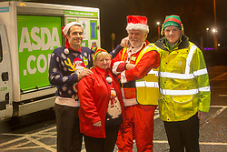 Andy Law, the Dundee Asda delivery driver that has become a hit with customers after dressing up as Santa. Pic with colleagues Craig Fisher, Dawn McCann and Cameron Watt,  .