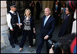 Secretary Of State Hillary Clinton with the Foreign Secretary William Hague walk into Number 10 Downing on the day The  US President Barack Obama visits No10 Downing Street, London, On day 2 of his UK tour, Wednesday May 25,2011. Photo By Andrew Parsons/Parsons Media