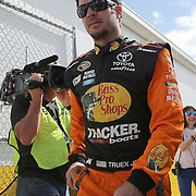 Race car driver Martin Truex Jr. is seen as he makes his way to the drivers meeting prior to the 58th Annual NASCAR Daytona 500 auto race at Daytona International Speedway on Sunday, February 21, 2016 in Daytona Beach, Florida.  (Alex Menendez via AP)