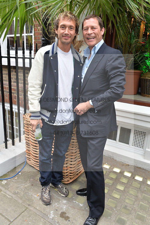 Left to right, VISCOUNT MACMILLAN and ARPAD BUSSON at the launch of the new collection from Limoland held at Anderson & Sheppard's Haberdashery, 17 Clifford Street,London on 16th June 2014.