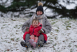 © Licensed to London News Pictures. 02/1/2021.Lottie 6, and Maxine, enjoy  sledging in the snow at North Park in Darlington following a snowfall last night. . Photo credit: Ioannis Alexopoulos/LNP <br /> <br /> **Permission Granted