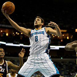 April 11, 2011; New Orleans, LA, USA; New Orleans Hornets shooting guard Marco Belinelli (8) shoots between Utah Jazz power forward Derrick Favors (15) and center Francisco Elson (16) during the second half at the New Orleans Arena. The Jazz defeated the Hornets 90-78.  Mandatory Credit: Derick E. Hingle