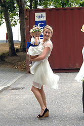 ROSE VAN CUTSEM and daughter  GRACE at the wedding of Nicholas Van Cutsem to Alice Hadden-Paton at The Guards Chapel, Wellington Barracks, London on 14th August 2009.
