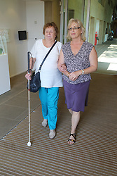 Woman with visual impairments with helper at the Yorkshire Sculpture Park.
