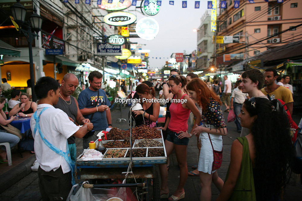 A man sells street food in Bangkok