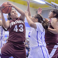 Ramah Mustang Idallas Yazzie (43) fights a rebound away from the Navajo Pine Warriors Friday at Navajo Pine High School.