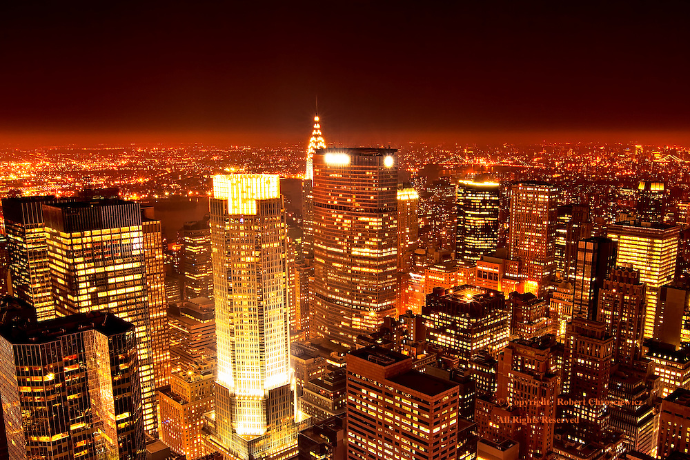 Vibrant Nightfall: A vibrant view of the New York skyline, with sky scrapers that shimmer and glow in the clear night air, from atop the Rockefeller Center, New York United States of America.