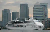 Azamara Journey in London for the first time.  The ship passing Canary Wharf, London UK...