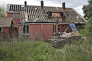 House being demolished, Shottisham, Suffolk, England asbestos roof tiles stacked up for safe removal.