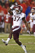 Texas A&M cornerback Alex Sezer, Jr. (37) reacts to a play during an NCAA college football game against the Arkansas Razorbacks in Fayetteville, Ark., Saturday, Sept. 28, 2013. Texas A&M defeated Arkansas 45-33. (AP Photo/Beth Hall)