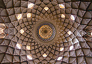 Stunning photographs reveal the beautiful ceilings in Iran's mosques, bazaars and public baths<br /> <br /> For the past few decades, restrictions on travel to Iran has meant the country has been largely shut off from the Western world, butas visa sanctions are lifted in the light of a landmark nuclear deal, the local tourism industry is hoping for a flurry of visitors.<br /> It's not hard to see why Iran is listed as one of the top travel destinations of 2016, with its rich culture and history.<br /> Among the standout aspects of the nation is its beautiful ancient architecture, with the cities and towns littered withornate and eye-catching mosques, public baths and markets.<br /> And unlike many other countries - the roof is not an afterthought, with many ceilings built as the centrepiece to the building, with many of the tile designs showcasing a display of intricate geometric patternsthatdate back several centuries.<br /> French photographerEric Lafforgue has travelled the country photographing the ceilings of indoor markets, mosques and bath houses.<br /> <br /> Photo shows: Ceiling With Its Intricate And Elaborate Patterns And Internal Stainless Glass Dome The Boroujerdi House