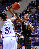 Missouri guard Alyssa Hollins (12) drives to the basket against pressure from Kansas State's Marlies Gipson (51) during the first half at Bramlage Coliseum in Manhattan, Kansas, January 13, 2007.  K-State beat the Tigers 81-66.