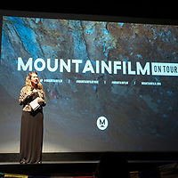 Kristen Milord, curator for Mountainfilm on Tour introduces films from the Mountainfilm Festival held annually in Telluride, Colorado, Friday, May 3 at the Morro Theatre in Gallup.