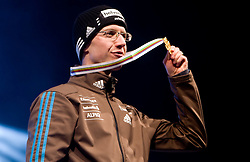 World champion Simon Ammann of Switzerland during medal ceremony after winning the Flying Hill Individual  at 3rd day of FIS Ski Flying World Championships Planica 2010, on March 20, 2010, Planica, Slovenia.  (Photo by Vid Ponikvar / Sportida)