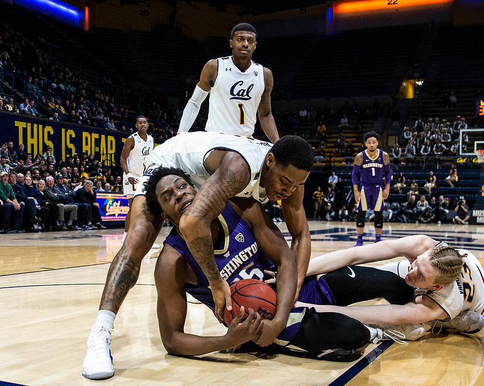 Feb 28 2019  Berkeley, CA, U.S.A. Washington forward Noah Dickerson (15) California guard Paris Austin (3) and  center Connor Vanover (23) fights for the rebound during the NCAA Men's Basketball game between the Washington Huskies and the California Golden Bears 73-76 lost at Hass Pavilion Berkeley Calif. Thurman James / CSM