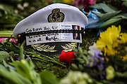 A navel cap sits amongst floral tributes to Prince Philip, Duke Of Edinburgh outside of Windsor Castle on Sunday, April 11, 2021. The Queen announced the death of her beloved husband, His Royal Highness Prince Philip, Duke of Edinburgh who died at age 99. HRH passed away peacefully on April 9th at Windsor Castle. (Photo/ Vudi Xhymshiti)