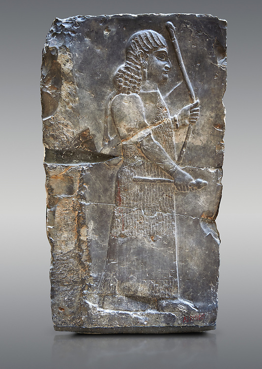 Stone relief sculptured panel of an archer. Inv AO 19885 from Dur Sharrukin the palace of Assyrian king Sargon II at Khorsabad, 713-706 BC.  Louvre Museum Room 4 , Paris