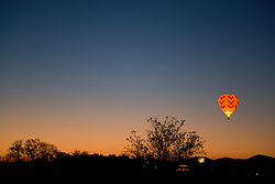 """""""Balloon Over Reno""""- This hot air balloon is part of the Dawn Patrol in The Great Reno Balloon Race."""