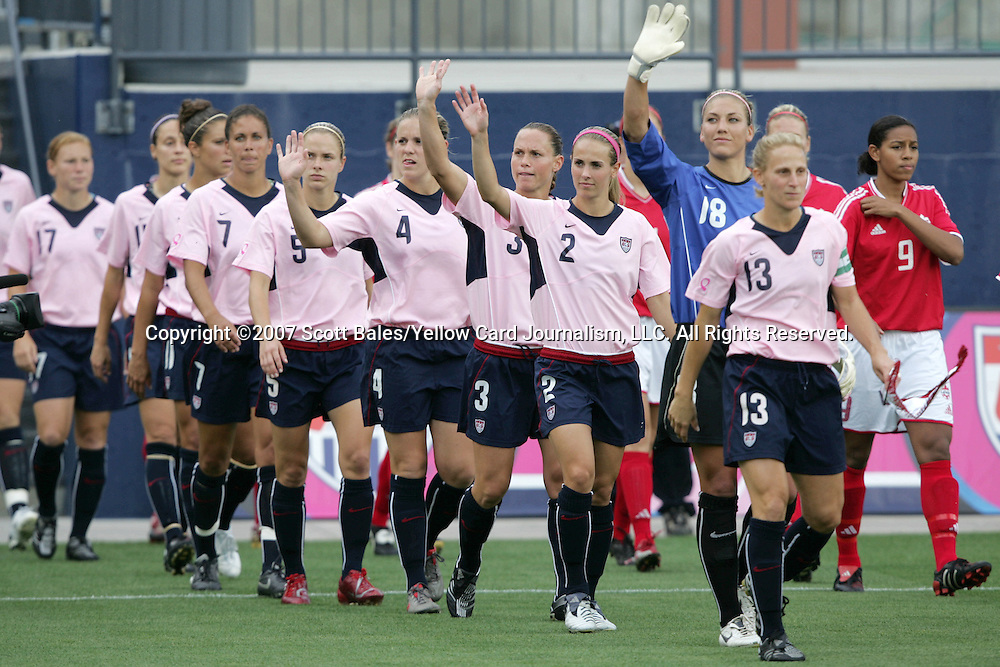 12 May 2007: The United States starting eleven walk out in their special pink jerseys, promoting breast cancer awareness, and wave to the crowd. The United States Women's National Team defeated the Women's National Team of Canada 6-2 at Pizza Hut Park in Frisco, Texas in an international friendly game.