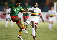 Fotball<br /> Foto: Dppi/Digitalsport<br /> NORWAY ONLY<br /> <br /> FOOTBALL - AFRICAN CUP OF NATIONS 2006 - FIRST ROUND - GROUP B - 060121 - CAMEROON v ANGOLA<br /> <br /> RIGOBERT SONG (CAM) / FABRICE AKWA (ANG) <br /> <br /> KAMERUN v ANGOLA