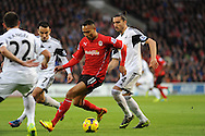 Peter Odemwingie of Cardiff City is challenged by Leon Brittan and Chico Flores of Swansea City.<br /> Barclays Premier League match, Cardiff city v Swansea city at the Cardiff city stadium in Cardiff, South Wales on Sunday 3rd Nov 2013. pic by Phil Rees, Andrew Orchard sports photography,