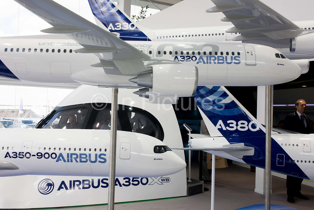 Airbus exhibition stand showing Airliner fleet of A350, A380, A320 and A330 at the Farnborough Air Show, England. Airbus is an aircraft manufacturing division of Airbus Group (formerly European Aeronautic Defence and Space Company). Based in Blagnac, France, a suburb of Toulouse, with production and manufacturing facilities mainly in France, Germany, Spain and the United Kingdom, the company produced 626 airliners in 2013. At the 2014 show, Airbus announced new business worth more than $75m for 496 aircraft, a new record for the company.