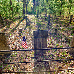 A small cemetery in the woods in Durham, New Hampshire.