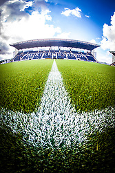An upright image of the Main Stand. The Falkirk Stadium, with the new pitch work for the Scottish Championship game v Morton. The woven GreenFields MX synthetic turf and the surface has been specifically designed for football with 50mm tufts compared with the longer 65mm which has been used for mixed football and rugby uses.  It is fully FFA two star compliant and conforms to rules laid out by the SPL and SFL.<br /> ©Michael Schofield.