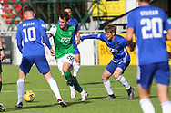 Melker Hallberg (20) of Hibernian dribbles through Cove Rangers Blair Yule (8) and scores a goal 1-0 and celebrates, celebration during the Betfred Scottish League Cup match between Cove Rangers and Hibernian at Balmoral Stadium, Aberdeen, Scotland on 10 October 2020.