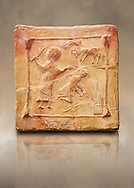 6th-7th Century Eastern Roman Byzantine  Christian Terracotta tiles depicting Abraham about to offer his son Isaac as a sacrifice<br />   - Produced in Byzacena -  present day Tunisia. <br /> <br /> These early Christian terracotta tiles were mass produced thanks to moulds. Their quadrangular, square or rectangular shape as well as the standardised sizes in use in the different regions were determined by their architectonic function and were designed to facilitate their assembly according to various combinations to decorate large flat surfaces of walls or ceilings. <br /> <br /> Byzacena stood out for its use of biblical and hagiographic themes and a richer variety of animals, birds and roses. Some deer and lions were obviously inspired from Zeugitana prototypes attesting to the pre-existence of this province's production with respect to that of Byzacena. The rules governing this art are similar to those that applied to late Roman and Christian art with, in the case of Byzacena, an obvious popular connotation. Its distinguishing features are flatness, a predilection for symmetrical compositions, frontal and lateral representations, the absence of tridimensional attitudes and the naivety of some details (large eyes, pointed chins). Mass production enabled this type of decoration to be widely used at little cost and it played a role as ideograms and for teaching catechism through pictures. Painting, now often faded, enhanced motifs in relief or enriched them with additional details to break their repetitive monotony.<br /> <br /> The Bardo National Museum Tunis, Tunisia