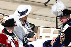 Queen Elizabeth II (left) with the Duchess of Cornwall and the Prince of Wales leave by carriage during the annual Order of the Garter Service at St George's Chapel, Windsor Castle.
