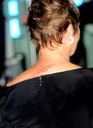 The 007, James Bond logo on the back of Dame Judi Dench's neck as she arrives for the World premiere of 'Quantum Of Solace' at the Odeon Leicester Square, WC2.