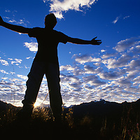 A hiker welcomes the sun after a cold night in the Cordillera Vilcabamba.
