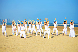 June 21, 2017 - Tsingtao, Tsingtao, China - Tsingtao, CHINA-June 21 2017: (EDITORIAL USE ONLY. CHINA OUT) ..Women practice yoga on beach in Tsingtao, east China's Shandong, June 21st, 2017, marking International Yoga Day. (Credit Image: © SIPA Asia via ZUMA Wire)
