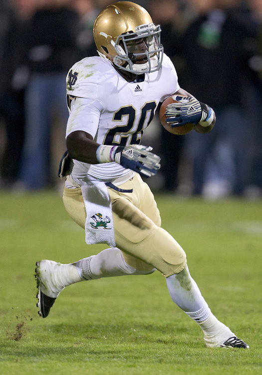 October 01, 2011:  Notre Dame running back Cierre Wood (#20) makes cut upfield on run from scrimmage during NCAA Football game action between the Notre Dame Fighting Irish and the Purdue Boilermakers at Ross-Ade Stadium in West Lafayette, Indiana.  Notre Dame defeated Purdue 38-10.