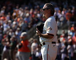 Oct 3, 2021; San Francisco, California, USA; San Francisco Giants third base coach Ron Wotus (8) stands for the national anthem before his team takes on the San Diego Padres at Oracle Park. Wotus coached his final regular season game Sunday, as he will retire after this season, his 31st with the Giants. Mandatory Credit: D. Ross Cameron-USA TODAY Sports