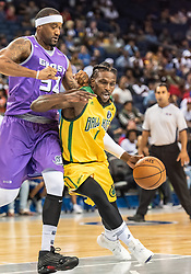July 6, 2018 - Oakland, CA, U.S. - OAKLAND, CA - JULY 06: Jermaine Taylor (1) of the Ball Hogs moves around Lee Nailon (54) of Ghost Ballers during game 2 in week three of the BIG3 3-on-3 basketball league on Friday, July 6, 2018 at the Oracle Arena in Oakland, CA (Photo by Douglas Stringer/Icon Sportswire) (Credit Image: © Douglas Stringer/Icon SMI via ZUMA Press)