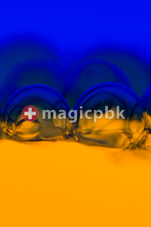 Bubbles seen in an Aura-Soma Equilibrium no. 32 (B32, Royal Blue / Gold) during a studio product photo session held at Aura-Soma Germany in Heiligenhaus, Germany, Saturday, Sept. 13, 2014. (Photo by Patrick B. Kraemer / MAGICPBK)