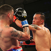 KISSIMMEE, FL - MARCH 06:  Juan Aguirre (R) catches Charles Natal with a left hook during the Telemundo Boxeo boxing match at the Kissimmee Civic Center on March 6, 2015 in Kissimmee, Florida. (Photo by Alex Menendez/Getty Images) *** Local Caption ***  Charles Natal; Juan Aguirre