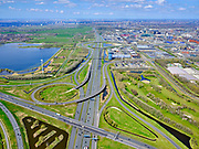 Nederland, Noord-Holland, Amsterdam; 17-04-2021; Knooppunt Holendrecht, A2, met in de voorgrond A9 naar Amstelveen. Midden Gaasperdammerweg, A9 richting Gooi. Midden links Oudekerkerplas.<br /> Holendrecht junction with A9 to Amstelveen in the foreground. Midden Gaasperdammerweg, A9 towards Gooi. Middle left Oudekerkerplas.<br /> <br /> luchtfoto (toeslag op standard tarieven);<br /> aerial photo (additional fee required)<br /> copyright © 2021 foto/photo Siebe Swart