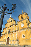 View of the yellow exterior of the La Recoleccion Church, Leon, Nicaragua