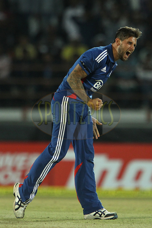 Jade Dernbach of England celebrates the wicket of MS Dhoni of India during the 1st Airtel ODI Match between India and England held at the SAURASHTRA CRICKET ASSOCIATION STADIUM, RAJKOT, India on the 11th January 2013..Photo by Ron Gaunt/BCCI/SPORTZPICS ..Use of this image is subject to the terms and conditions as outlined by the BCCI. These terms can be found by following this link:..http://www.sportzpics.co.za/image/I0000SoRagM2cIEc