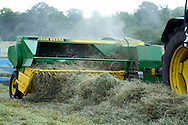Close up of baler baling hay