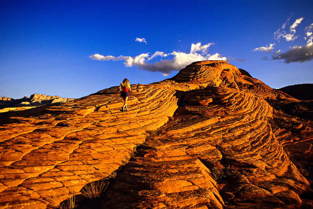 Woman running, Snow Canyon State Park, near Ivins (near St. George), Utah USA
