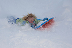 North America, United States, Washington, girl sledding at Crystal Mountain.  MR