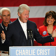 Former President Bill Clinton (center) speaks as Florida Democratic gubernatorial candidate Charlie Crist and running mate Annette Taddeo, attend a campaign event on Monday, Nov. 3, 2014, at the UCF Arena in Orlando, Fla. Crist, a former Florida Republican governor, is running against Republican Florida Gov. Rick Scott.  (AP Photo/Alex Menendez)