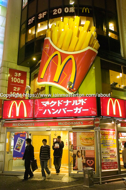 Entrance to McDonalds restaurant at night in central Tokyo Japan